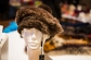 Knitted beaver beret with fox pom, $195 - The Pink Mink